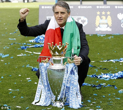 Roberto Mancini celebrates with the trophy