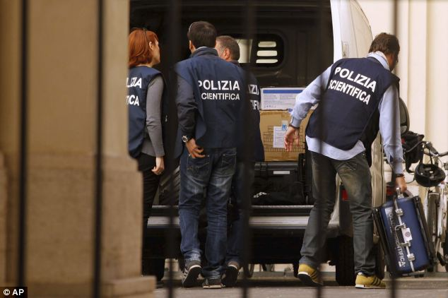 Forensic police unload equipment in the courtyard of Sant' Apollinare Basilica, in Rome
