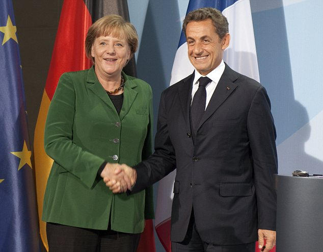 Radical departure: Angela Merkel and France's former President Nicolas Sarkozy had similar austere ideas about the future of Europe and were dubbed 'Merkozy'