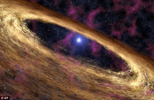 A pulsar star, circled by the remnants of planets and solar material, drifts through the vacuum of space (file picture)