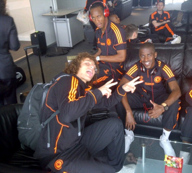 Here we go: Chelsea players (from left) David Luiz, Didier Drogba and Ramires preparing to fly out to Munich