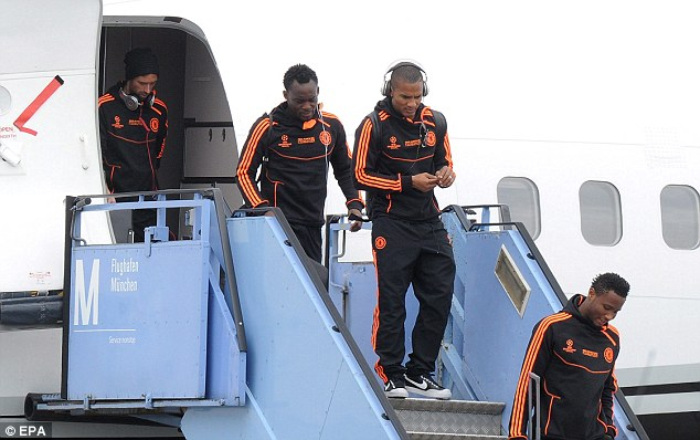 Let's go! Raul Meireles, Michael Essien, Florent Malouda and John Obi Mikel leave the plane