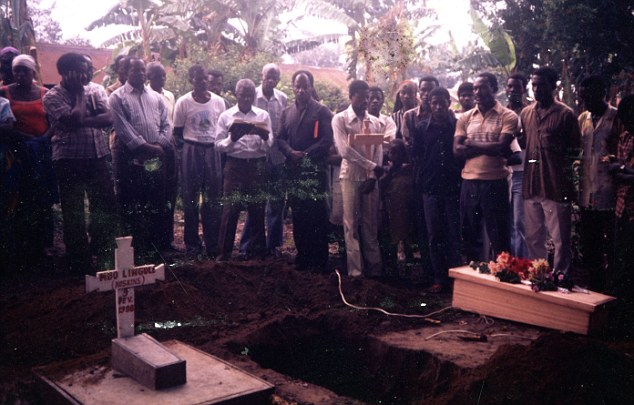 Emotional: Mourners gather at Abigail's graveside - she was buried next to her twin sister