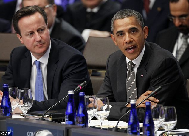 'The war is over': President Barack Obama, accompanied by Prime Minister David Cameron, speaking during the meeting on Afghanistan during the NATO Summit in Chicago yesterday