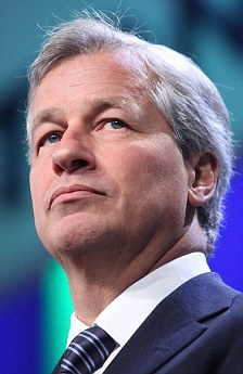 Losses: JP Morgan boss Jamie Dimon has announced the curtailment of the bank's $15billion share buy back