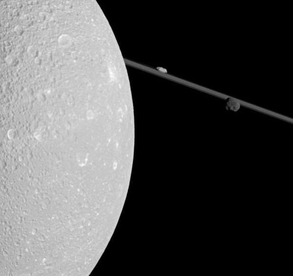 Spectacular View Of Saturn' Moon Dione Captured Cassini Probe Hurtles Daily Mail Online