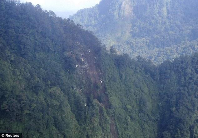 Crash site: Wreckage of the Russian Sukhoi Superjet 100 aircraft shown strewn across Mount Salak, West Java province