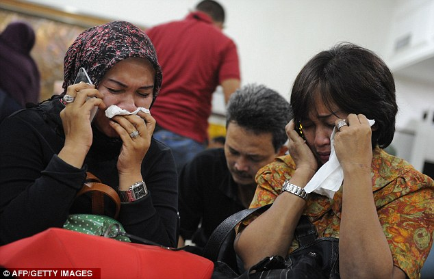 Grief-stricken: Indonesian relatives of passengers on the jet at Halim Perdanakusuma airport in Jakarta on May 10, as rescuers searched for survivors at the crash site
