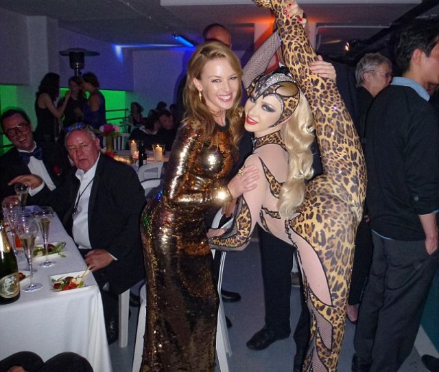 Show Stopping Contortionist Zlata Poses With Australian Singer Kylie Minogue At The Cannes Film Festival