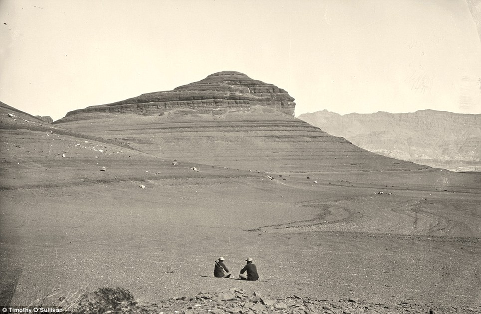 Barren: Two men sit looking at headlands north of the Colorado River Plateau in 1872