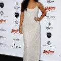 Amber lounge fashion show in monaco wearing a floor length white dress