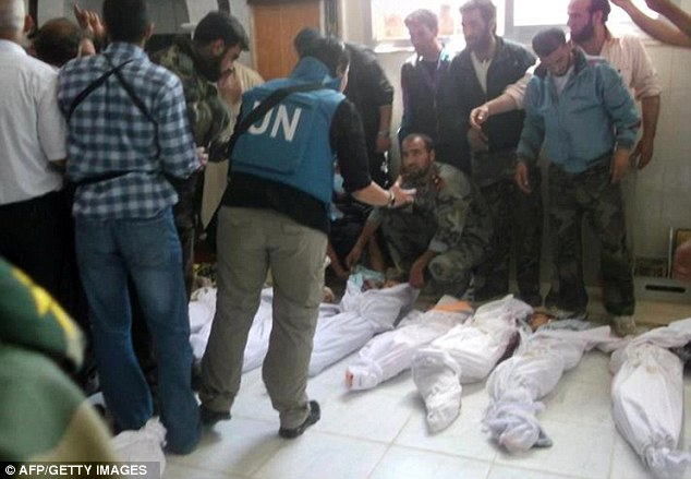 UN probe: A handout picture of the bodies piled up in Syria, as released by the opposition's Shaam News Network