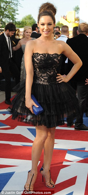 Black swan: Kelly Brook stuns at the 2012 Bafta Television Awards at the Royal Festival Hall in London