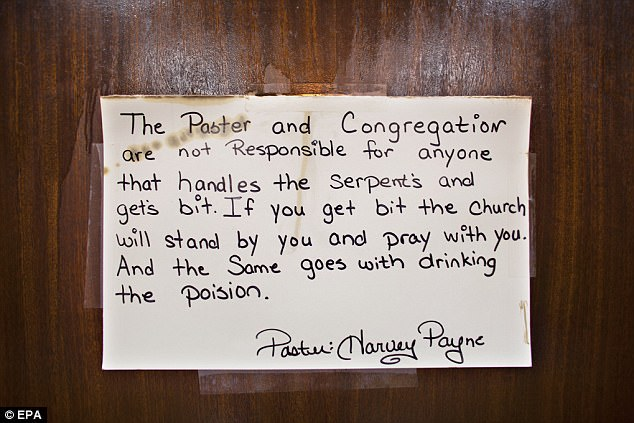 A handwritten sign on the altar warns members of the consequences of picking up snakes and drinking strychnine
