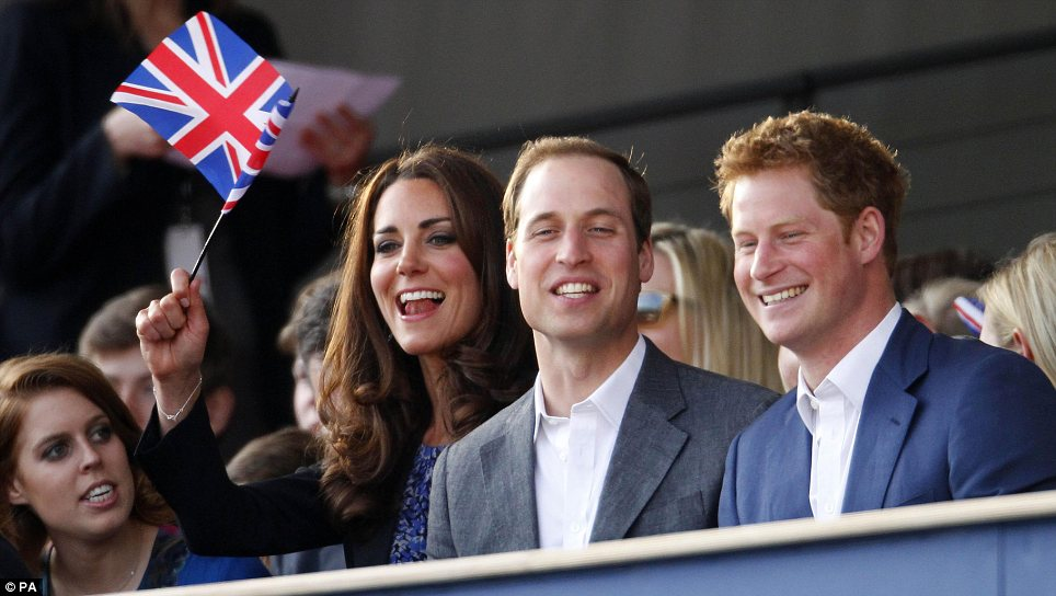 Cheryl's a hit! Prince William and Harry were seen beaming while Kate waved her flag with plenty of enthusiasm