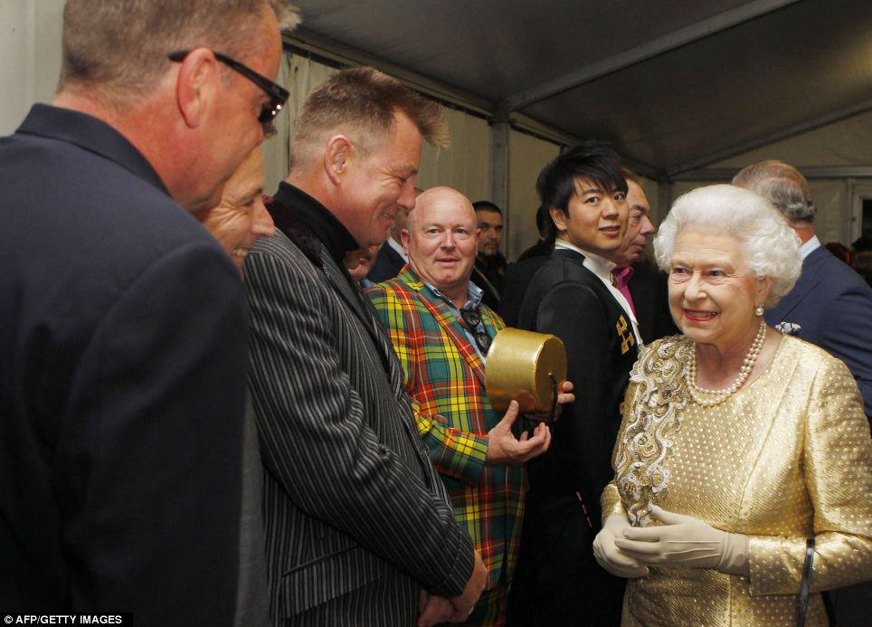 Welcome to Our House! Queen Elizabeth II greets British band Madness backstage