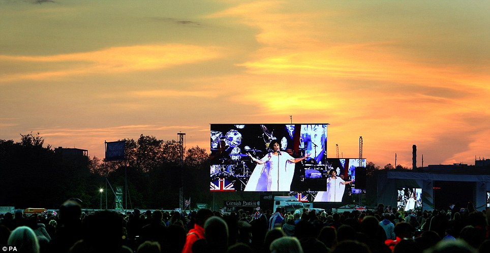 Red sky delight: Crowds in Hyde Park watch singing legend Shirley Bassey on the big screen against a beautiful sunset during the concert