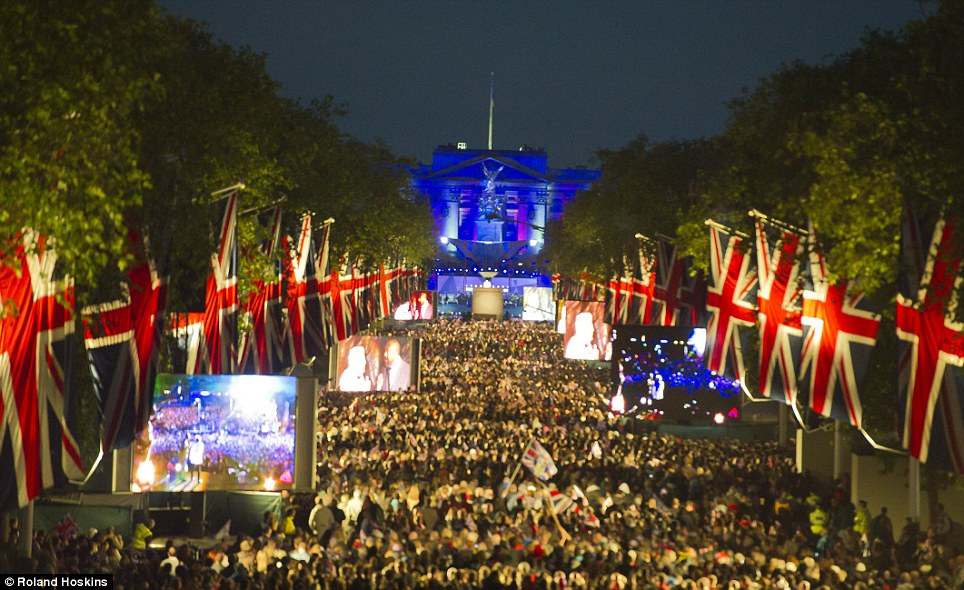 Festival fever: Thousands of royal fans pack out the Union Flag-lined Mall in London, where they were able to watch the Diamond Jubilee Concert at Buckingham Palace