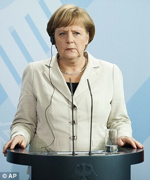 German chancellor Angela Merkel, left, said today she has not pressured Spain into asking for a bailout