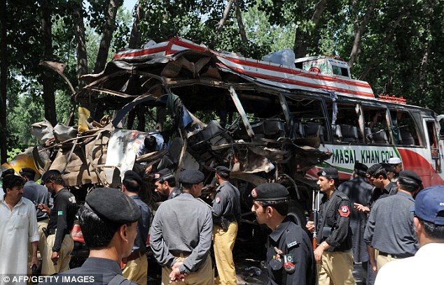 Horrific: Witnesses said they saw body parts scattered around the smouldering wreck of the bus