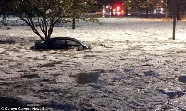Inundated: Colorado was hit with so much hail that some cars were left almost completely submerged