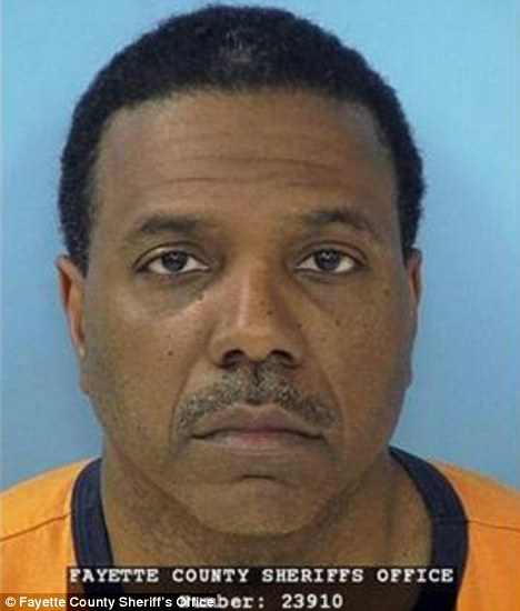 Mug: Creflo Dollar, pictured, was arrested for 'slightly hurting' his 15-year-old daughter in a fight at his Atlanta home