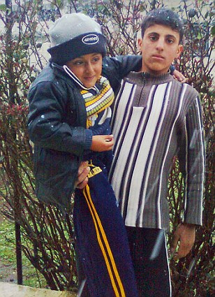 Firas, pictured holding his brother Abdullah who suffered from cerebal palsy. Firas said he wanted to become a doctor so he could help his sibling