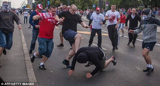 In similar incidents nearby the stadium more sets of Polish fans target a Russian outside the stadium