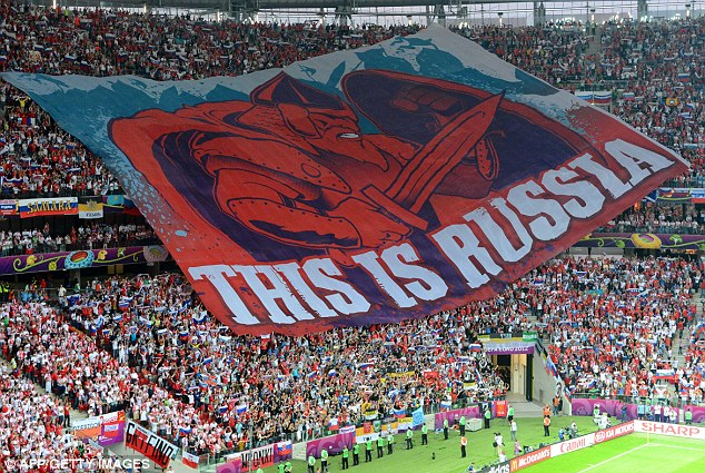 Message: Russia's football fans display a giant banner during the Euro 2012 championships football match against Poland