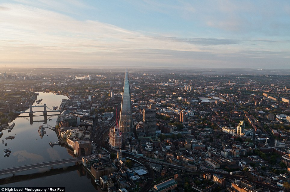 The incredible photos of London taken from a helicopter show that the newest addition to the skyline, The Shard at London Bridge, dominates the foreground