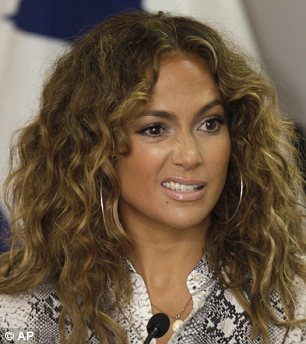 Jennifer Lopez Embraces Her Natural Curls As She Visits