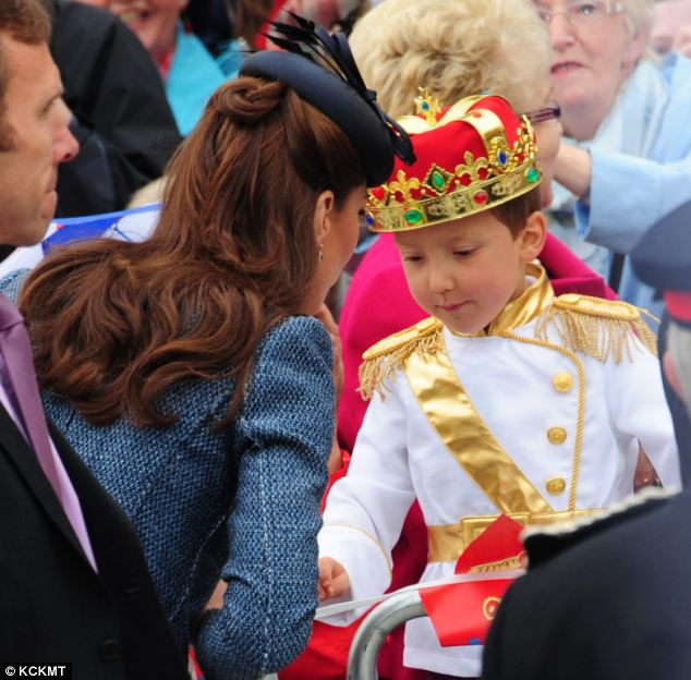 Special greeting: Kind Kate meets a boy wearing a regal outfit to rival her own