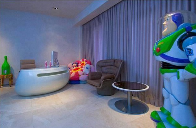 To infinity...: Buzz Lightyear grins in the corner of Kanye West's plush home but was unable to defend the star's property from being burgled earlier this week