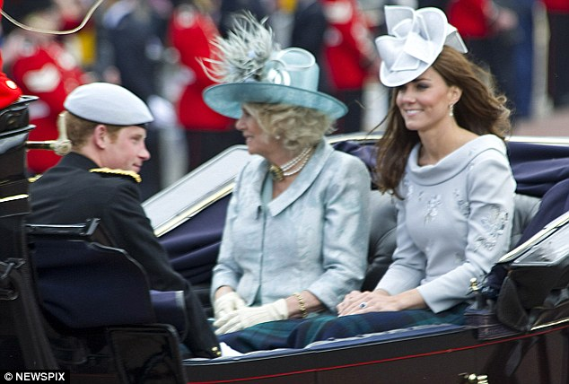 Smiles: Kate travelled to the Horseguards Parade with Prince Harry and the Duchess of Cornwall