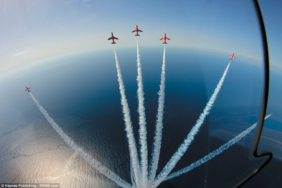 Starburst: Six jets splay out over the sea in one of the stunning photos which have been compiled for 'Red Arrows in Camera', a stunning photographic record of the world of the Reds