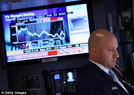 Bad news: A grim-faced trader looks on as shares on the Dow slide by 2%