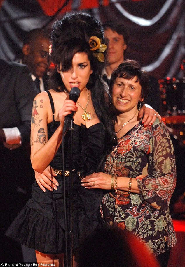 Golden moments: Amy with her mother Janis during her live broadcast of her Grammy's performance