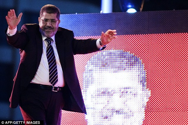 Accidental leader: Mohammed Morsi waves to the crowd during a presidential campaign rally
