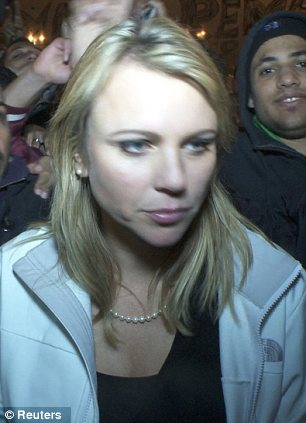 Attacked: CBS reporter Lara Logan moments before she was assaulted in February 2011