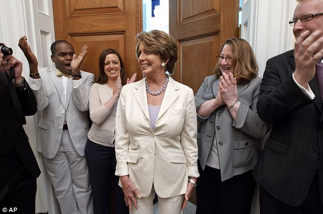 Proud: Nancy Pelosi celebrated with staff during the moments after the ruling was announced