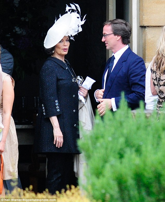 Mother of the bride: Bianca Jagger looked very chic in a big white hat