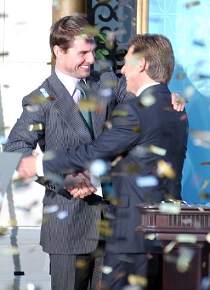 Best friends: Confetti rains down as US actor Tom Cruise, left, embraces David Miscavige during the official opening of a new Scientology church in Madrid