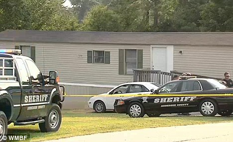 Witness: The boy's mother entered the bedroom inside this trailer and saw the boy hold the gun up to his head right when he fired