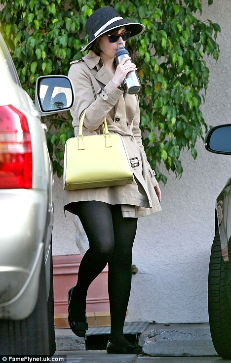 Incognito: The actress covered up in sunglasses and a hat as she left the class sipping water