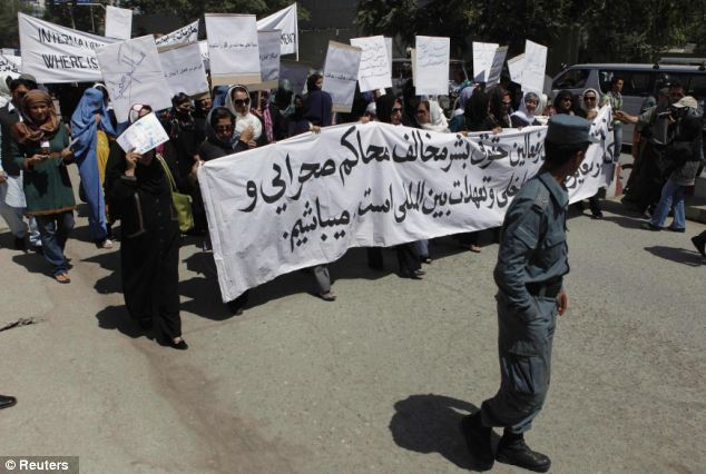Demands for justice: The protest was sparked by the recent execution of an Afghan woman in Parwan province. But women's groups are calling on the Afghan government to do more for equal rights