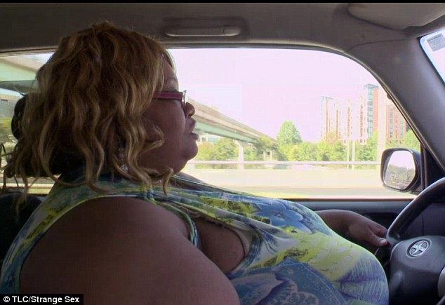 Uncomfortable: She refuses to wear a seatbelt as she drives because it pulls too tight across the breasts