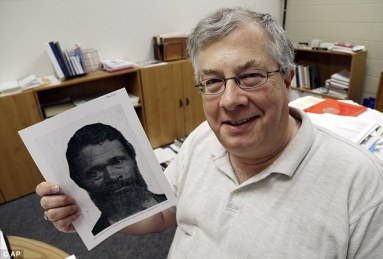 Investigation: Roy Finkenbine, from the University of Detroit, holds a print showing Jordan Anderson. Finkenbine is planning to write a biography of the remarkable former slave