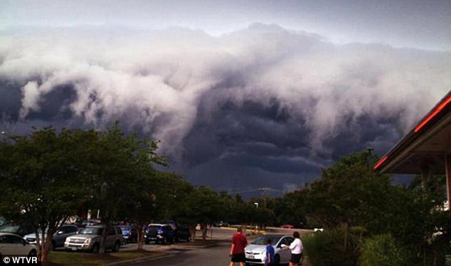 Threatening: These remarkable pictures make the cloud look like an enormous wave