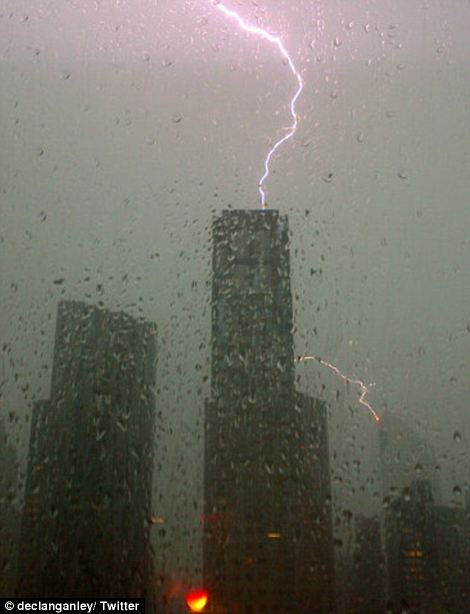 Hitting the skyscrappers: The Citibank Building (left) and the Bloomberg Building (right) were both hit by lightening during the afternoon storm