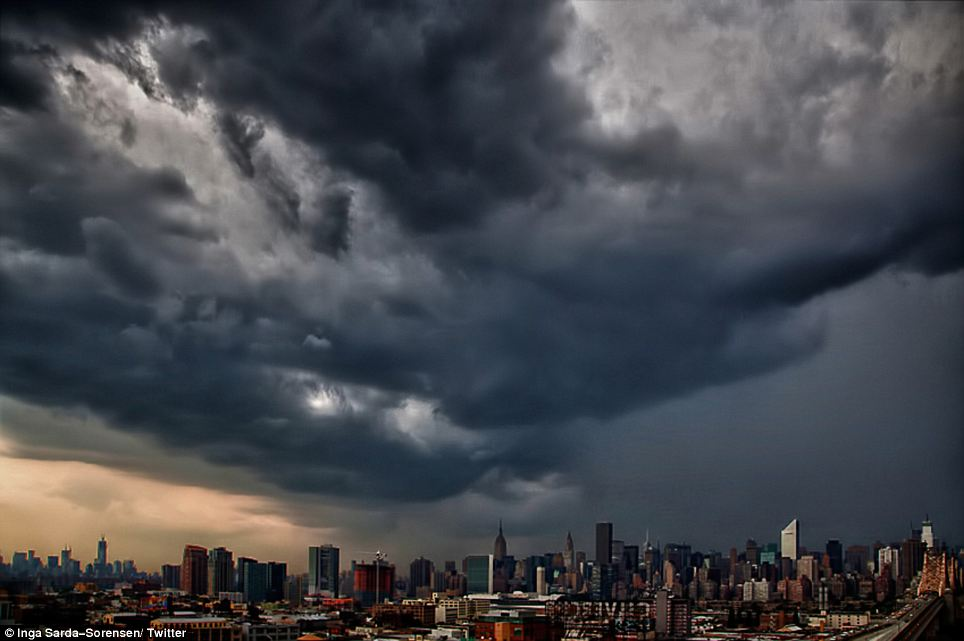 The approaching storm: The threatening clouds collecting over the Manhattan skyline gave a clear impression of the dark weather to come
